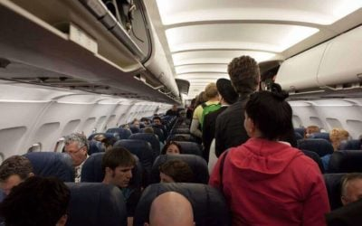 Why do airlines overbook flights & How not to get bumped into them?
